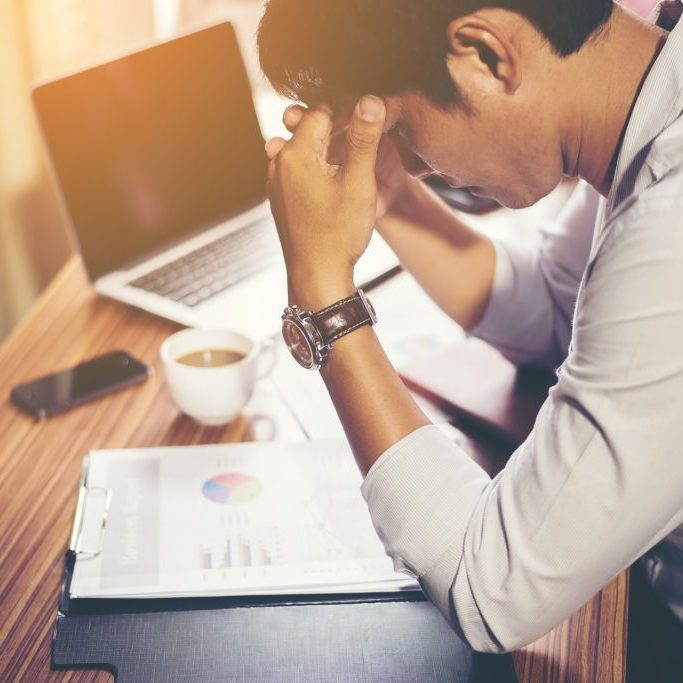 Stressed man looking at finances